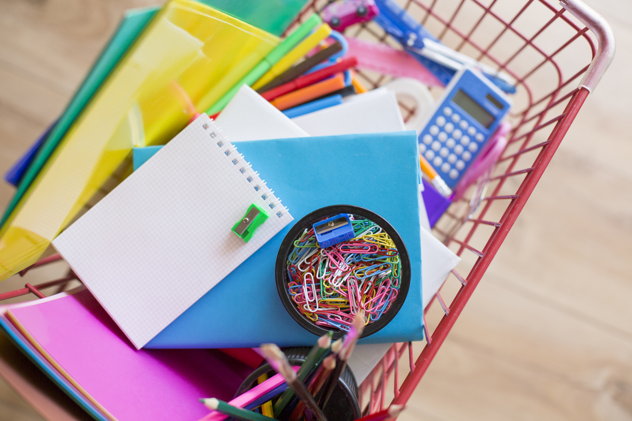 Shopping basket with school supplies
