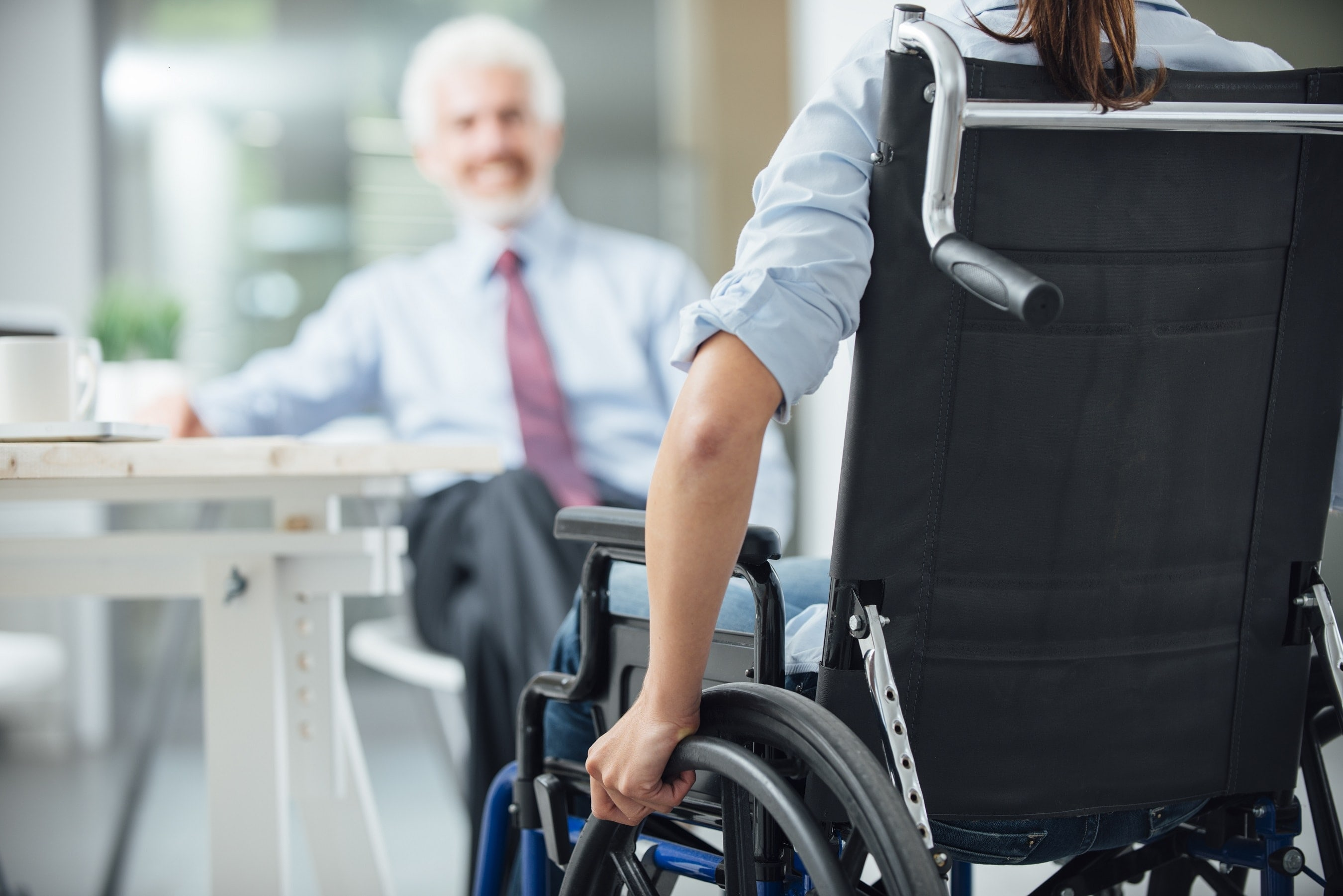 Woman in wheelchair in business meeting