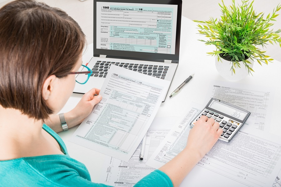Woman Filling Out Her Taxes