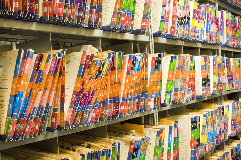 Medical records filling shelves