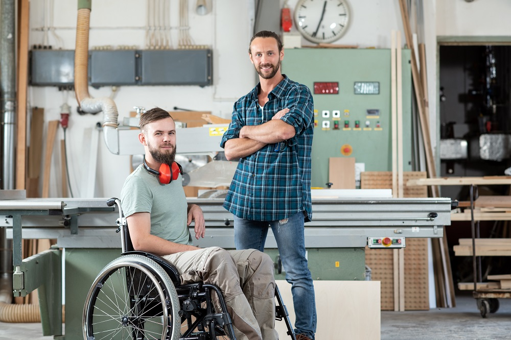 Disabled carpenter and coworker