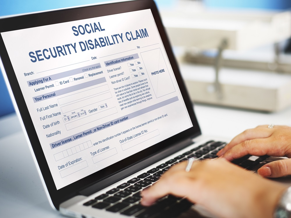 Person Applying For Social Security Benefits on Laptop