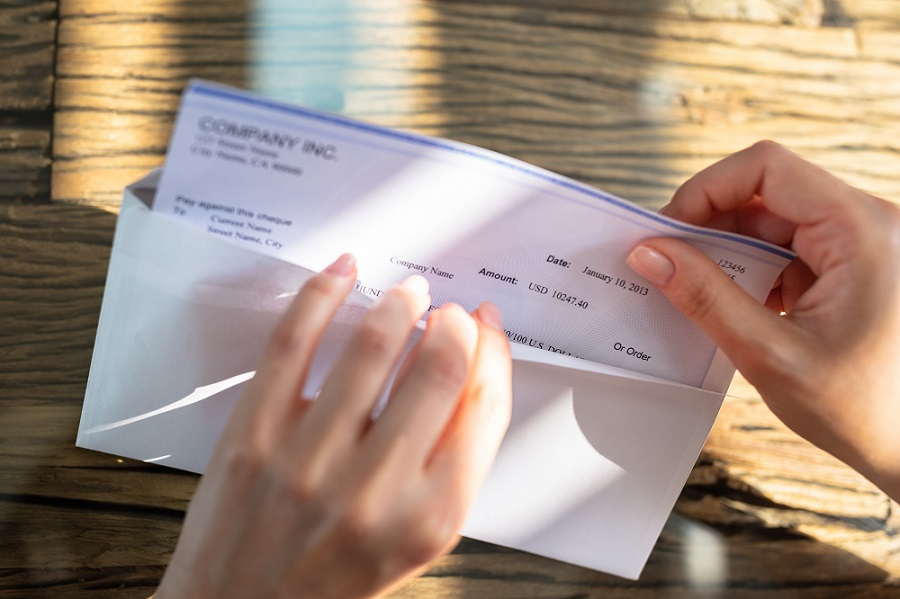 Opening Envelope with Paycheck