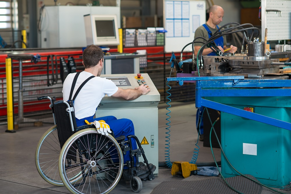 Disabled Worker in Wheelchair Working in Factory