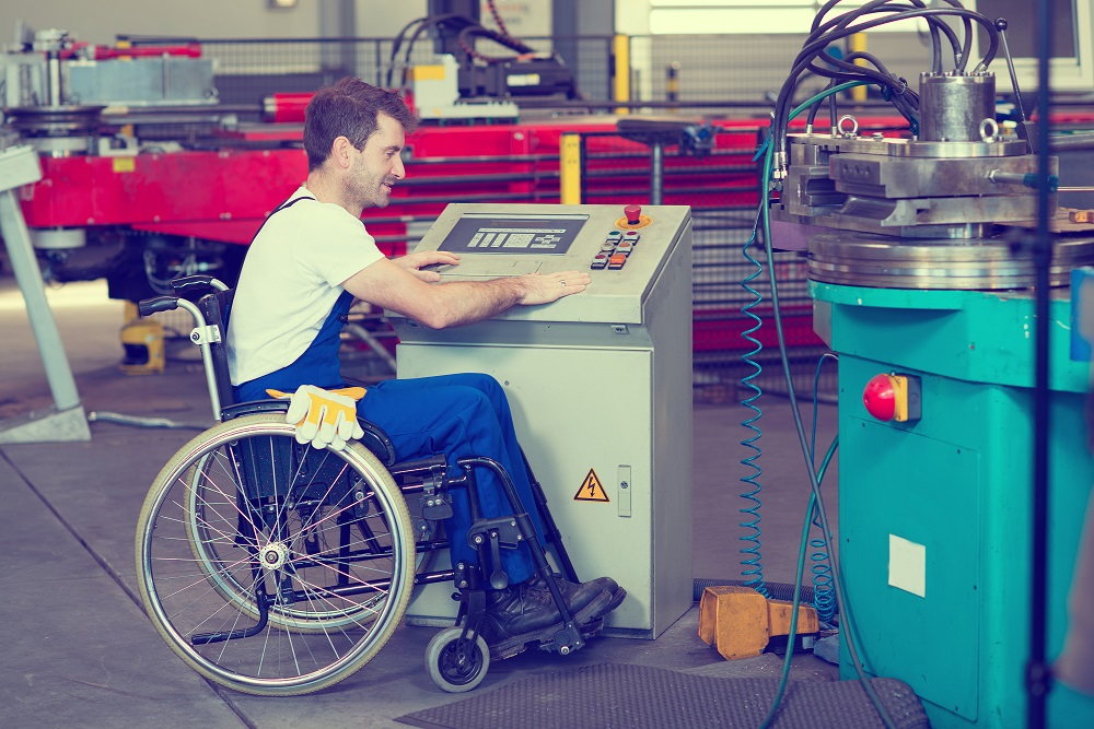 Man in Wheelchair Working in Factory